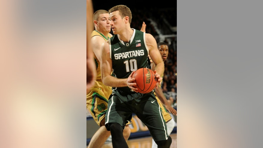 Michigan State forward Matt Castello (10) drives the lane while Notre Dame forward Martinas Geben defends during first-half action in an NCAA college basketball game Wednesday, Dec. 3, 2014, in South Bend, Ind. (AP Photo/Joe Raymond)