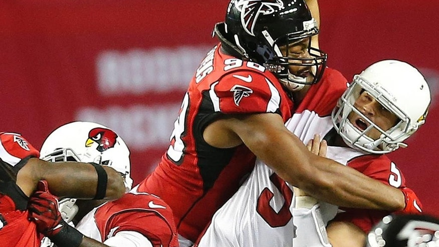 Atlanta Falcons defensive end Stansly Maponga (90) hits Arizona Cardinals quarterback Drew Stanton (5) causing a fumble during the second half of an NFL football game, Sunday, Nov. 30, 2014, in Atlanta. (AP Photo/John Bazemore)