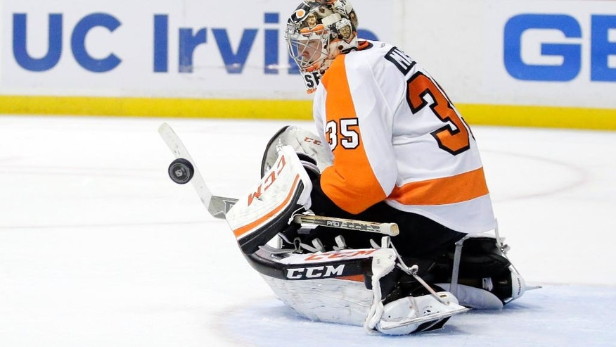 Philadelphia Flyers goalie Steve Mason blocks a shot against the Anaheim Ducks during the second period of an NHL hockey game in Anaheim, Calif., Wednesday, Dec. 3, 2014. (AP Photo/Chris Carlson)