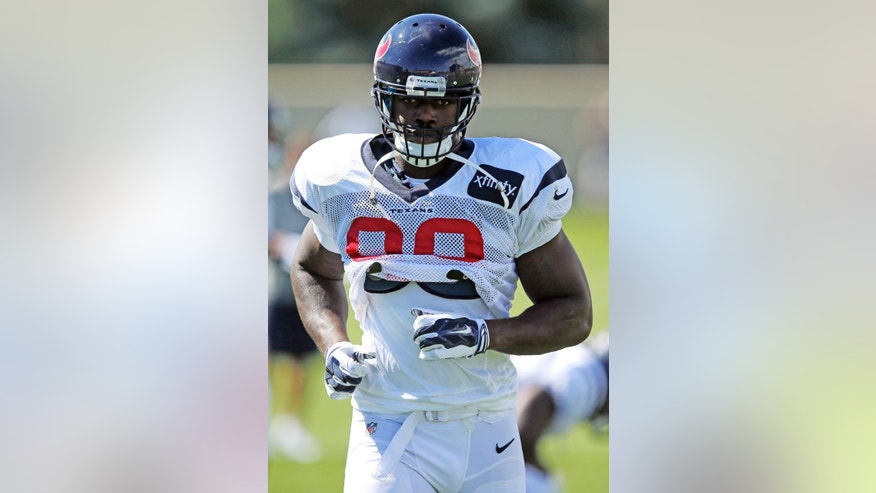 FILE - In this Aug. 20, 2014, file photo, Houston Texans linebacker Jadeveon Clowney runs a drill during a joint practice between the Denver Broncos and the Texans in Englewood, Colo. Top overall pick Jadeveon Clowney will have a second knee surgery, ending his season for the Houston Texans, Thursday, Dec. 4, 2014. (AP Photo/Jack Dempsey, File)