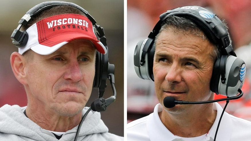 FILE - At left, in a Nov. 8, 2014, file photo, Wisconsin head coach Gary Andersen looks on during an NCAA college football game against Purdue in West Lafayette, Ind. At right, in an Aug. 30, 2014, file photo, Ohio State head coach Urban Meyer walks on the field in the second half of an NCAA college football game against Navy in Baltimore. Coaches and players say walk-ons like Ohio State's Kosta Karageorge _ who was found dead of an apparently self-inflicted gunshot on Sunday, Nov. 30, 2014, are treated just as well as their highly recruited teammates. Meyer and Andersen, the opposing coaches in Saturday's Big Ten championship game, believe things have gotten better since their own walk-on experiences. Meyer walked on at Cincinnati in the 1980s at the same time that Anderson was walking on at Ricks College. Andersen said he tries to make sure walk-ons are treated the same as his scholarship players. (AP Photo/File)
