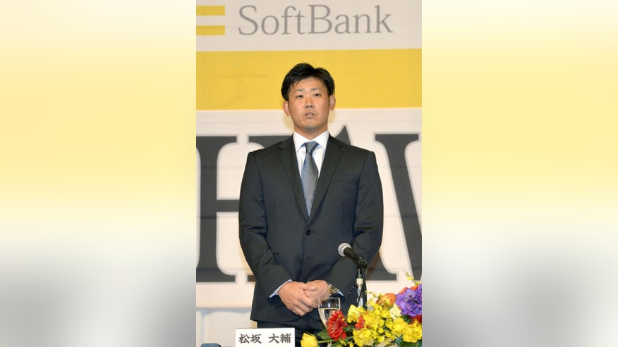 Daisuke Matsuzaka attends a press conference at a hotel in Fukuoka, western Japan Friday, Dec. 5, 2014. Matsuzaka has signed a contract with the Softbank Hawks of Japan's Pacific League after eight years in Major League Baseball. (AP Photo/Kyodo News) JAPAN OUT, MANDATORY CREDIT