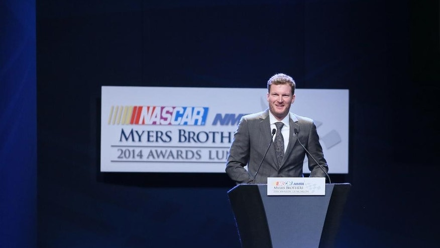 Dale Earnhardt Jr. speaks after receiving the NMPA Myers Brothers award during the NASCAR NMPA Myers Brothers Awards Luncheon, Thursday, Dec. 4, 2014, in Las Vegas. NASCAR drivers are in Las Vegas for Champion's Week. (AP Photo/Ronda Churchill)