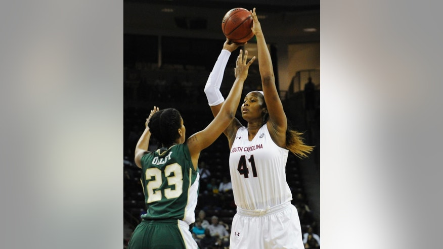 South Carolina center Alaina Coates (41) looks to pass as Charlotte forward Kenya Olley (23) defends during the first half of an NCAA college basketball game, Thursday, Dec. 4, 2014, in Columbia, S.C. (AP Photo/Rainier Ehrhardt)
