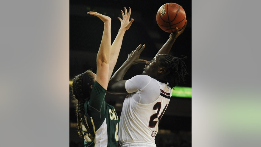 South Carolina forward Aleighsa Welch (24) shoots over Charlotte guard Hillary Sigmon (22) during the first half of an NCAA college basketball game, Thursday, Dec. 4, 2014, in Columbia, S.C. (AP Photo/Rainier Ehrhardt)