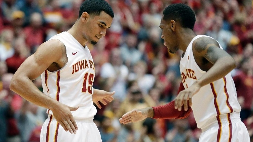 Iowa State guard Naz Long, left, celebrates with teammate Monte Morris, right, during a timeout in the first half of an NCAA college basketball game against Arkansas, Thursday, Dec. 4, 2014, in Ames, Iowa. (AP Photo/Charlie Neibergall)