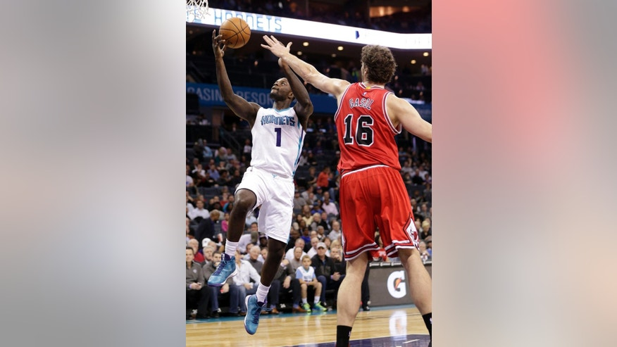 Charlotte Hornets' Lance Stephenson (1) drives past Chicago Bulls' Pau Gasol (16) during the first half of an NBA basketball game in Charlotte, N.C., Wednesday, Dec. 3, 2014. (AP Photo/Chuck Burton)