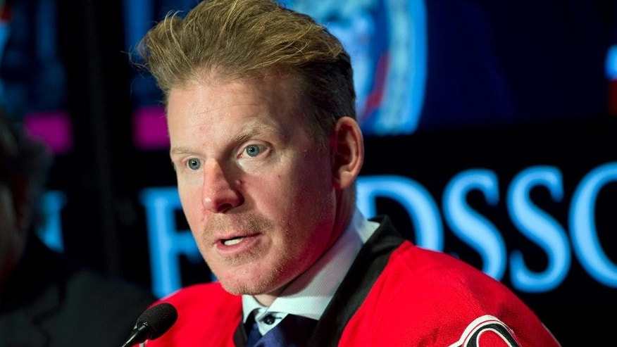 Former Ottawa Senators captain Daniel Alfredsson speaks during an NHL hockey a news conference announcing his retirement, Thursday, Dec. 4, 2014 in Ottawa.  The Senators signed their longtime captain to a one-day contract so he can skate in pre-game warm-ups with the team one last time tonight and take a ceremonial faceoff before they play the New York Islanders. (AP Photo/The Canadian Press, Adrian Wyld)