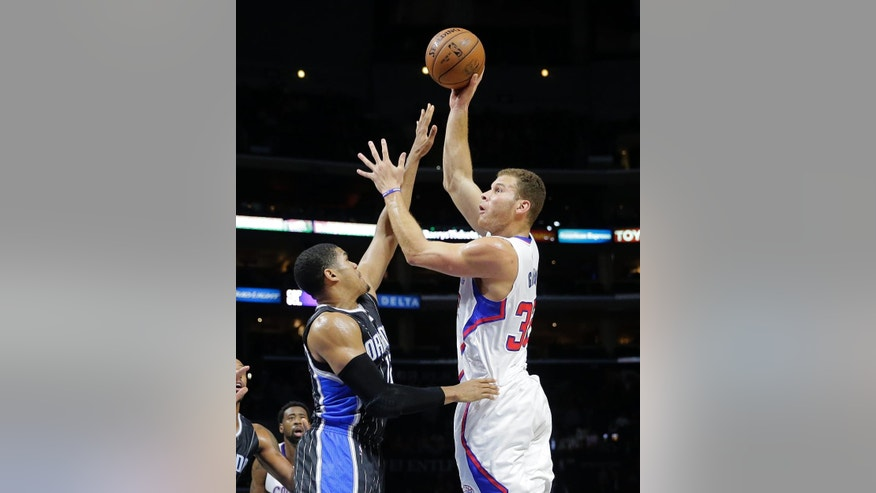 Los Angeles Clippers' Blake Griffin, right, shoots over Orlando Magic's Tobias Harris during the first half of an NBA basketball game Wednesday, Dec. 3, 2014, in Los Angeles. (AP Photo/Jae C. Hong)