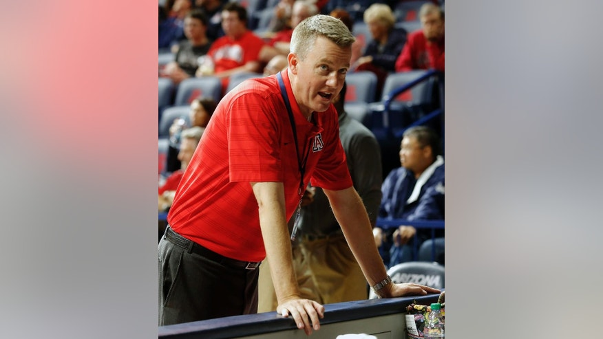 In this Tuesday, Dec. 2, 2014 photo, Arizona Vice President for Athletics, Greg Byrne looks on during the first half of an NCAA college basketball game against Gardner Webb in Tucson, Ariz. Byrne became Arizona's athletic director in 2010 and has led the department to unprecedented heights. (AP Photo/Rick Scuteri)