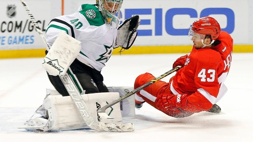 Dallas Stars goalie Jussi Rynnas (40) stops a Detroit Red Wings center Darren Helm (43) shot in the second period during an NHL hockey game in Detroit Thursday, Dec. 4, 2014. (AP Photo/Paul Sancya)