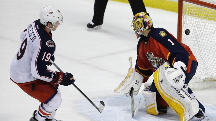 Columbus Blue Jackets center Ryan Johansen (19) watches after scoring the game winning goal against Florida Panthers goalie Roberto Luongo (1) in a shootout of an NHL hockey game, Thursday, Dec. 4, 2014,  in Sunrise, Fla. The Columbus Blue Jackets defeated the Florida Panthers 4-3 in a shootout. (AP Photo/Lynne Sladky)
