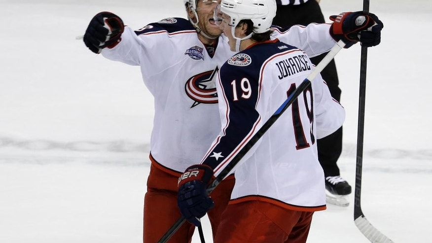 Columbus Blue Jackets left wing Scott Hartnell, left, celebrates with center Ryan Johansen (19) after Johansen scored the game winning goal in a shootout of an NHL hockey game against the Florida Panthers, Thursday, Dec. 4, 2014,  in Sunrise, Fla. The Columbus Blue Jackets defeated the Florida Panthers 4-3 in a shootout. (AP Photo/Lynne Sladky)