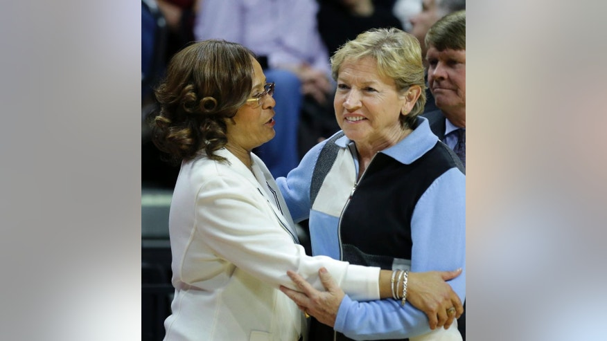 Rutgers head coach C. Vivian Stringer, left, greets North Carolina head coach Sylvia Hatchell before the teams played a women's NCAA college basketball game Thursday, Dec. 4, 2014, in Piscataway, N.J. North Carolina won 96-93 in double overtime. (AP Photo/Mel Evans)