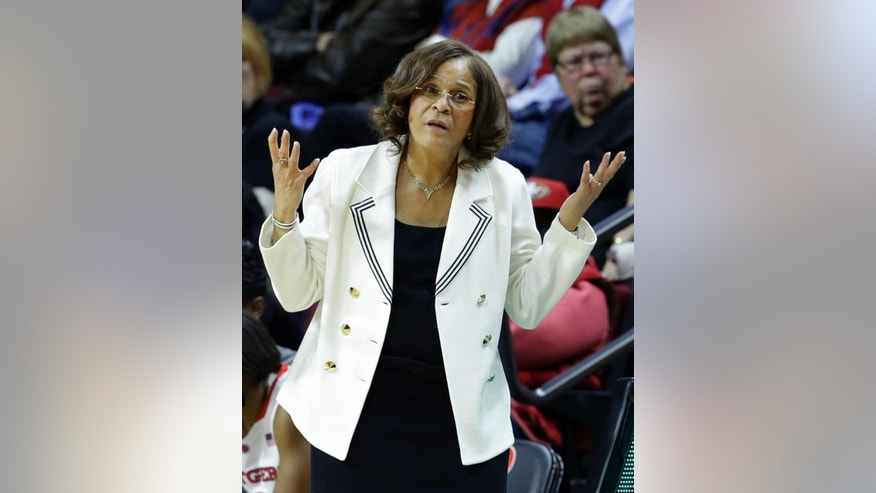 Rutgers head coach C. Vivian Stringer reacts to play during the second half of a women's NCAA college basketball game against North Carolina Thursday, Dec. 4, 2014, in Piscataway, N.J. North Carolina won 96-93 in double overtime. (AP Photo/Mel Evans)