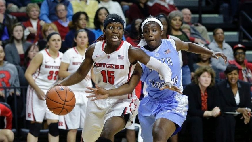 Rutgers' Syessence Davis (15) drives to the basket as North Carolina's Jamie Cherry (0) tries to block her path during the second half of an NCAA college basketball game Thursday, Dec. 4, 2014, in Piscataway, N.J. (AP Photo/Mel Evans)