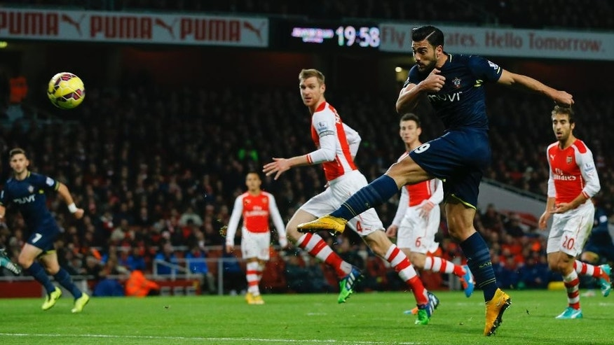 Southampton's  Graziano Pelle tries a shot on goal during the English Premier League soccer match between Arsenal and Southampton at Emirates stadium in London, Wednesday, Dec. 3, 2014. (AP Photo/Kirsty Wigglesworth)