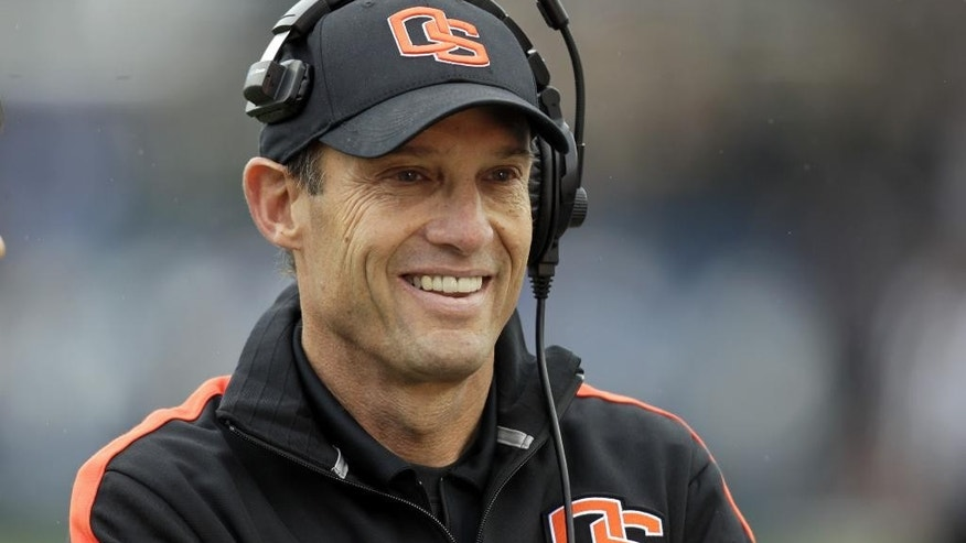 FILE - In this Oct. 13, 2012, file photo, Oregon State head coach Mike Riley smiles before the start of an NCAA college football game against BYU in Provo, Utah. Nebraska has hired Riley as its new football coach on Thursday, Dec. 4, 2014, replacing the fired Bo Pelini. (AP Photo/Rick Bowmer, File)