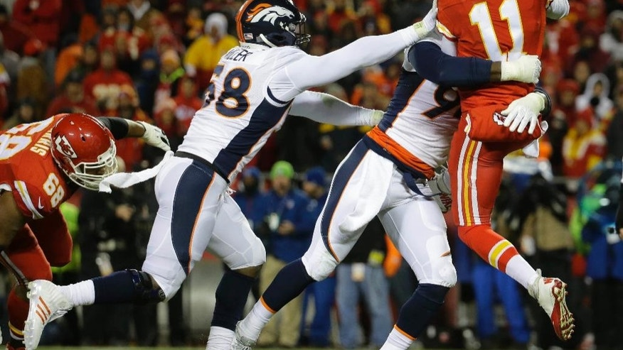 Denver Broncos outside linebacker Von Miller (58) and defensive end DeMarcus Ware (94) stop Kansas City Chiefs quarterback Alex Smith (11) in the first half of an NFL football game in Kansas City, Mo., Sunday, Nov. 30, 2014. (AP Photo/Charlie Riedel)