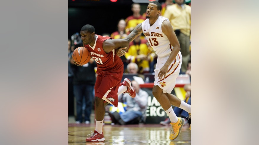 Arkansas guard Manuale Watkins, left, runs down a loose ball ahead of Iowa State guard Bryce Dejean-Jones, right, during the second half of an NCAA college basketball game, Thursday, Dec. 4, 2014, in Ames, Iowa. (AP Photo/Charlie Neibergall)