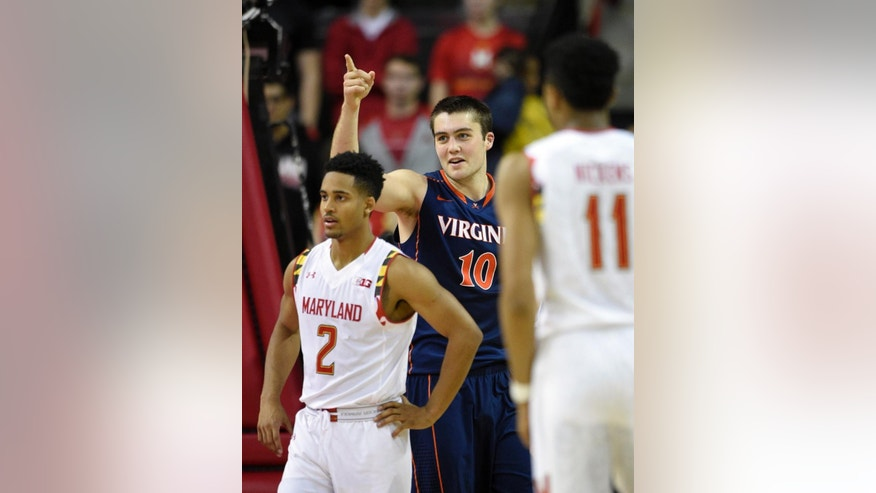 Virginia forward/center Mike Tobey (10) reacts after he was fouled during the second half of an NCAA college basketball game as Maryland guard Melo Trimble (2) and Jared Nickens (11) look on, Wednesday, Dec. 3, 2014, in College Park, Md. Virginia won 76-65. (AP Photo/Nick Wass)