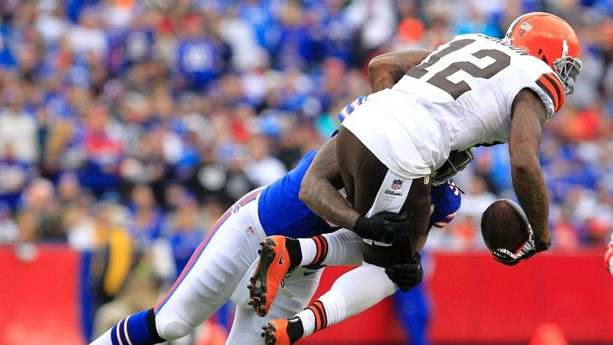 Cleveland Browns wide receiver Josh Gordon, right, is hit by Buffalo Bills middle linebacker Brandon Spike during the first half of an NFL football game, Sunday, Nov. 30, 2014, in Orchard Park, N.J. (AP Photo/Bill Wippert)
