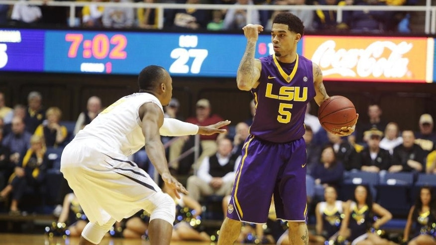 LSU guard Josh Gray (5) signals a play while being defended by West Virginia guard Jevon Carter (2) during an NCAA college basketball game, Thursday, Dec. 4, 2014, in Morgantown, W.Va. (AP Photo/Raymond Thompson)