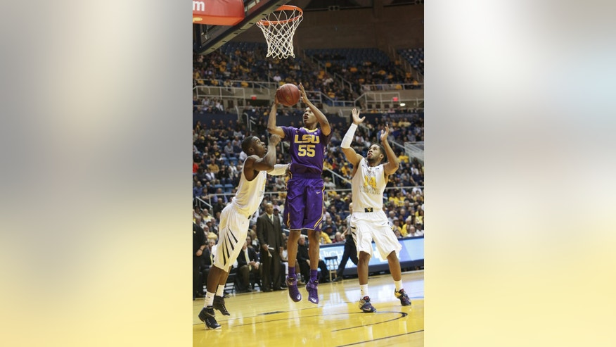LSU guard Tim Quarterman (55) drives past West Virginia forward BillyDee Williams (21) and guard Gary Browne (14) during an NCAA college basketball game, Thursday, Dec. 4, 2014, in Morgantown, W.Va. (AP Photo/Raymond Thompson)