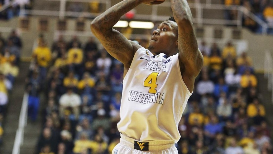 West Virginia Daxter Miles Jr. (4) takes a jump shot during an NCAA college basketball game against LSU, Thursday, Dec. 4, 2014, in Morgantown, W.Va. (AP Photo/Raymond Thompson)