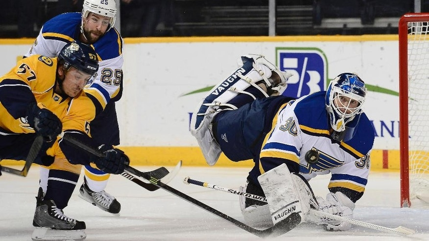 Nashville Predators left wing Gabriel Bourque (57) has his shot blocked by St. Louis Blues goalie Martin Brodeur (30) in the first period of an NHL hockey game Thursday, Dec. 4, 2014, in Nashville, Tenn. (AP Photo/Mark Zaleski)
