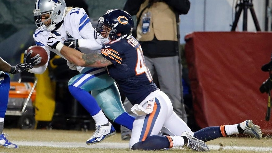Dallas Cowboys wide receiver Cole Beasley (11) dives against Chicago Bears free safety Chris Conte (47) to the end zone for a touchdown after receiving a pass from quarterback Tony Romo (9) during the second half of an NFL football game Thursday, Dec. 4, 2014, in Chicago. (AP Photo/Charles Rex Arbogast)
