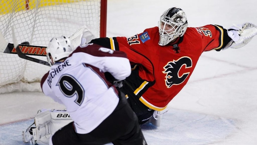 Colorado Avalanche's Matt Duchene, left, scores on Calgary Flames goalie Karri Ramo, from Finland, during the second period of an NHL hockey game, Thursday, Dec. 4, 2014 in Calgary, Alberta. (AP Photo/The Canadian Press, Larry MacDougal)