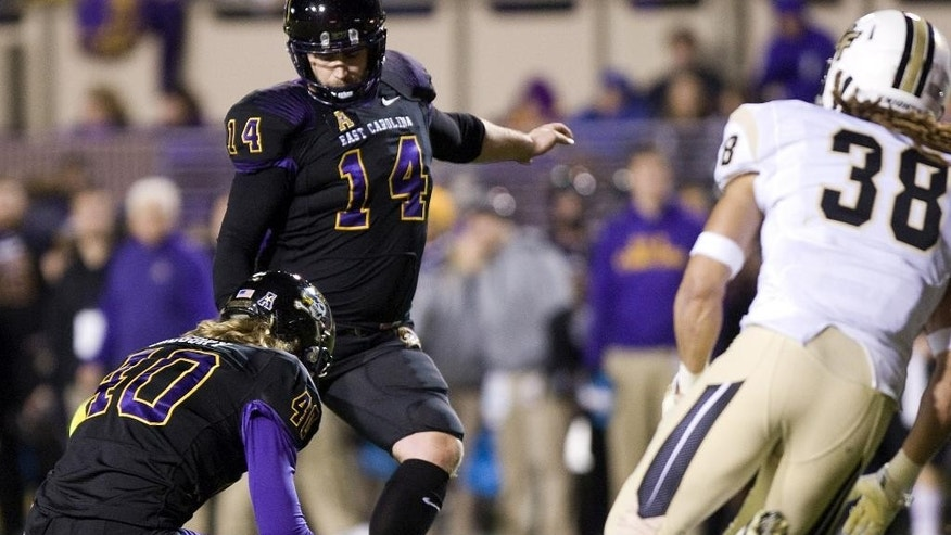 East Carolina's Warren Harvey kicks an extra point during an NCAA college football game, Thursday, Dec. 4, 2014 in Greenville, N.C. (AP Photo/The Daily Reflector, Scott Davis)