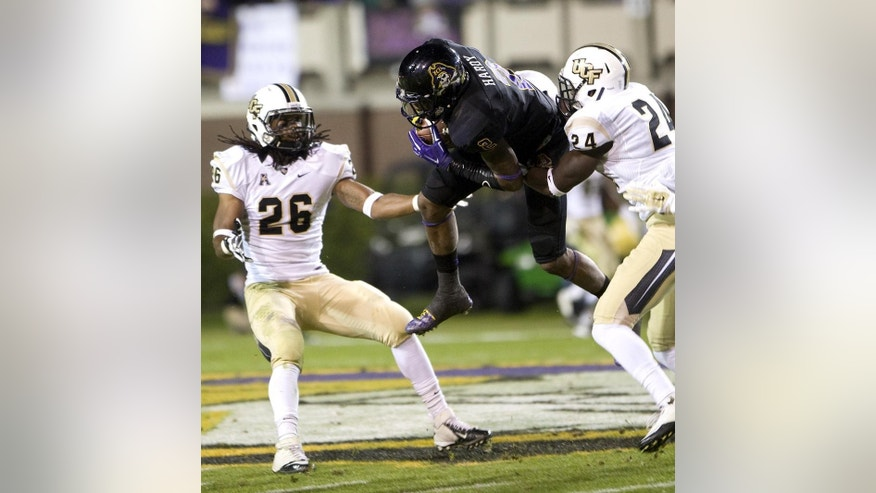 East Carolina's Justin Hardy (2) is taken down after completing a catch by UCF's D.J. Killings (24) as Clayton Geathers (26) looks on during an NCAA college football game, Thursday, Dec. 4, 2014 in Greenville, N.C. (AP Photo/The Daily Reflector, Scott Davis)