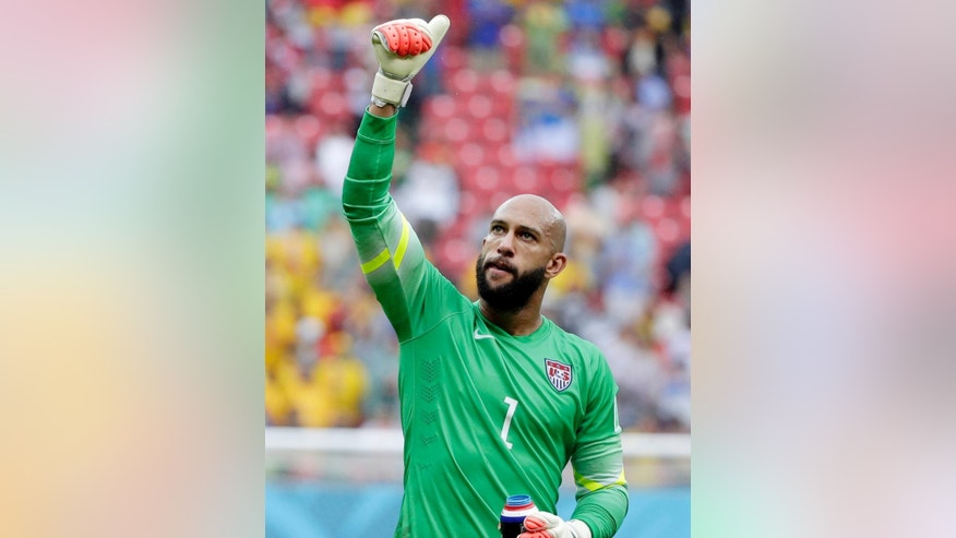 FILE - In this June 26, 2014, file photo, United States' goalkeeper Tim Howard gives a thumbs up to supporters after qualifying for the next round of the World Cup soccer tournament following their 1-0 loss to Germany at the Arena Pernambuco in Recife, Brazil. Howard has won the 2014 Player of the Year award on Thursday, Dec. 4, 2014, for his work with the U.S. national team.  It is the first time Howard has won the prestigious honor given to a U.S. team member by Futbol de Primera.  (AP Photo/Ricardo Mazalan, File)