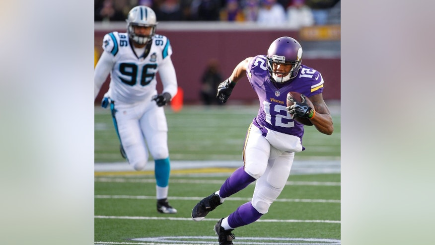 Minnesota Vikings wide receiver Charles Johnson, right, runs from Carolina Panthers defensive end Wes Horton after making a reception during the first half of an NFL football game, Sunday, Nov. 30, 2014, in Minneapolis. (AP Photo/Ann Heisenfelt)