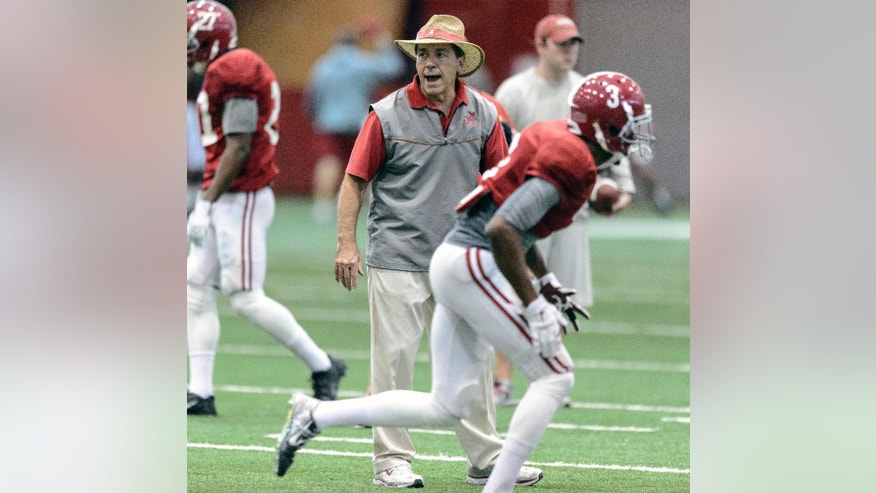 Alabama head coach Nick Saban tracks his defensive backs as they work through drills during an Alabama NCAA college football practice, Tuesday, Dec. 2, 2014, in Tuscaloosa, Ala. (AP Photo/AL.com, Vasha Hunt)