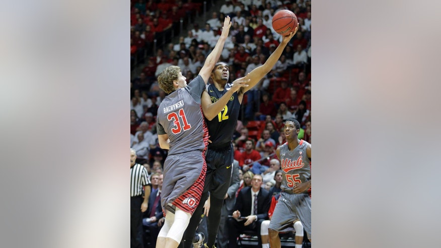 Wichita State forward Darius Carter (12) shoots as Utah center Dallin Bachynski (31) defends in the second half during an NCAA college basketball game Wednesday, Dec. 3, 2014, in Salt Lake City. (AP Photo/Rick Bowmer)