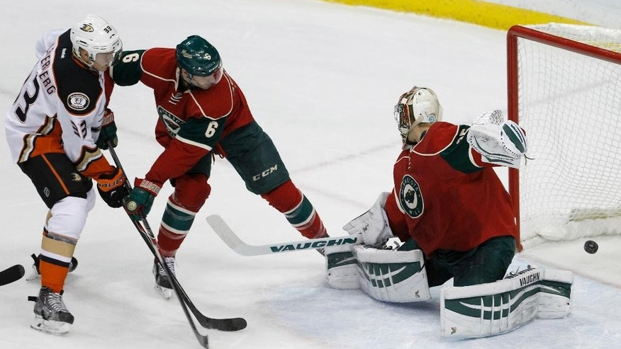 Anaheim Ducks right wing Jakob Silfverberg (33), of Sweden, scores on Minnesota Wild goalie Darcy Kuemper, right, as Wild defenseman Marco Scandella (6) tries to stop him during the first period of an NHL hockey game in St. Paul, Minn., Friday, Dec. 5, 2014. (AP Photo/Ann Heisenfelt)