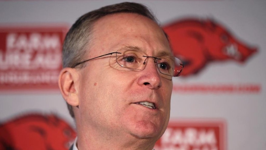 FILE - In this Sept. 15, 2014, file photo, University of Arkansas athletic director Jeff Long speaks during a news conference in Little Rock, Ark. Long will be in the spotlight when he announces the four teams in the first College Football Playoff on Sunday. (AP Photo/Danny Johnston, File)