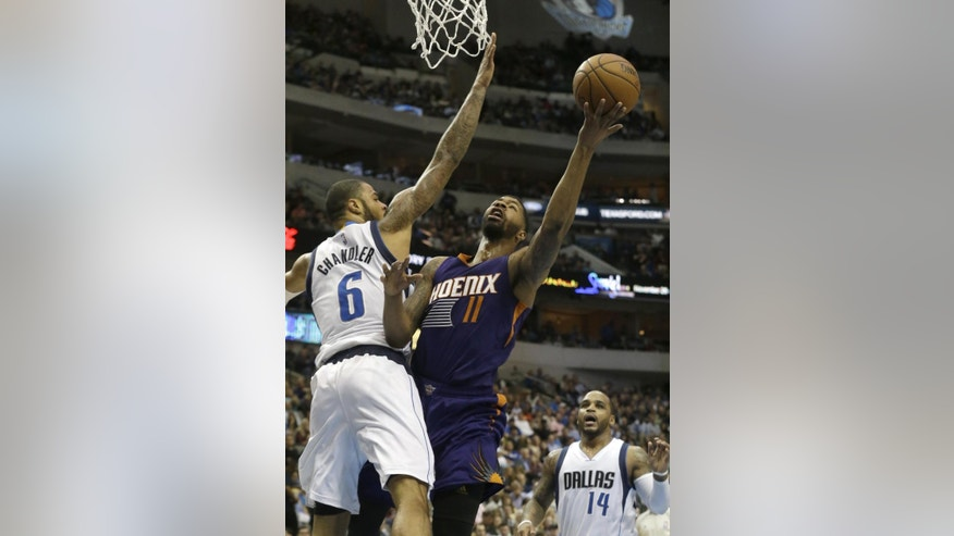 Phoenix Suns forward Markieff Morris (11) shoots against Dallas Mavericks center Tyson Chandler (6) as Jameer Nelson (14)  looks on during the first half of an NBA basketball game Friday, Dec. 5, 2014, in Dallas. The Suns won 118-106. (AP Photo/LM Otero)