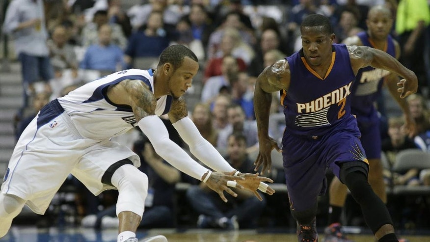 Phoenix Suns guard Eric Bledsoe (2) and Dallas Mavericks guard Monta Ellis (11) chase a loose ball during the first half of an NBA basketball game Friday, Dec. 5, 2014, in Dallas. (AP Photo/LM Otero)