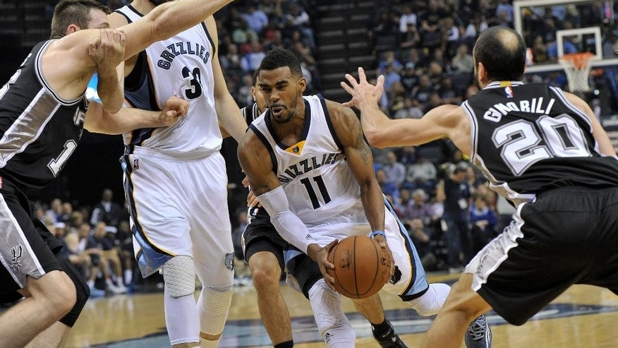 Memphis Grizzlies center Marc Gasol (33) sets a screen against San Antonio Spurs forward Aron Baynes, left, as Grizzlies guard Mike Conley (11) drives past Spurs guard Manu Ginobili (20) in the first half of an NBA basketball game Friday, Dec. 5, 2014, in Memphis, Tenn. (AP Photo/Brandon Dill)