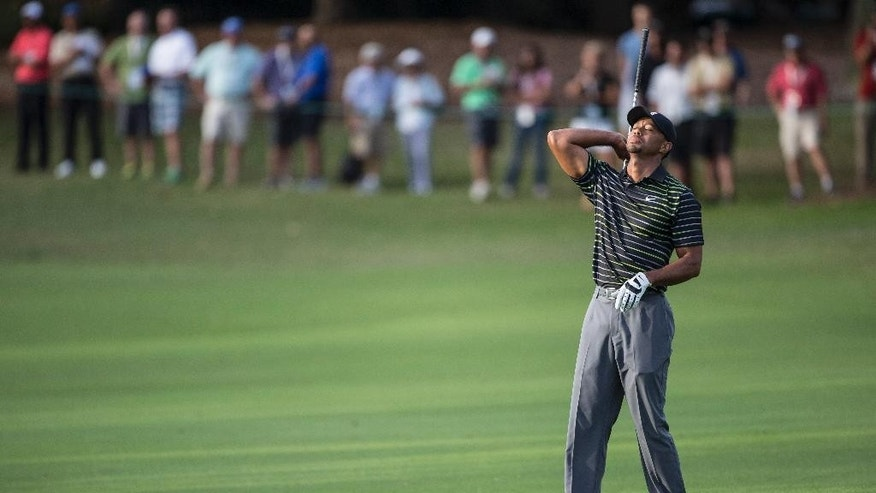 Tiger Woods shows his frustration after his last shot on the 18th fairway during the first round of the Hero World Challenge golf tournament on Thursday, Dec. 4, 2014, in Windermere, Fla. Woods finished the day in last place. (AP Photo/Willie J. Allen Jr.)