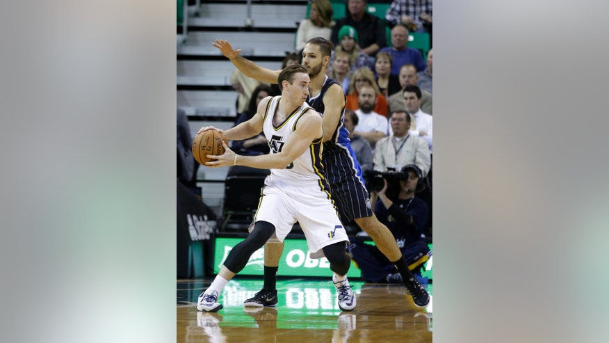 Orlando Magic's Evan Fournier, rear, guards Utah Jazz's Gordon Hayward (20) In the first quarter during an NBA basketball game Friday, Dec. 5, 2014, in Salt Lake City. (AP Photo/Rick Bowmer)