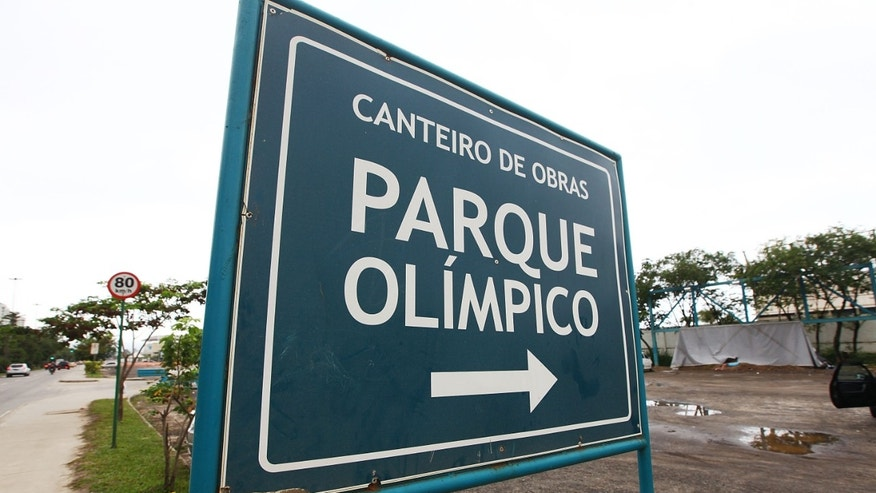 A sign points to the entrance to Olympic Park, the primary set of venues being built for the Rio 2016 Olympic Games.