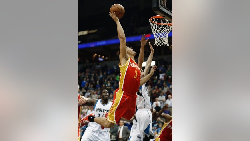 Houston Rockets guard Nick Johnson (3) scores the game winning basket during an NBA basketball game against the Minnesota Timberwolves, Friday, Dec, 5, 2014, in Minneapolis. The Rockets won 114-112 in overtime. (AP Photo/Stacy Bengs)