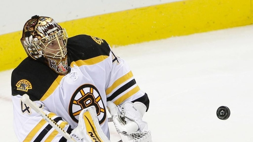 Boston Bruins goalie Tuukka Rask, of Finland, deflects a shot on goal during the second period of an NHL hockey game against the San Jose Sharks Thursday, Dec. 4, 2014, in San Jose, Calif. (AP Photo/Marcio Jose Sanchez)