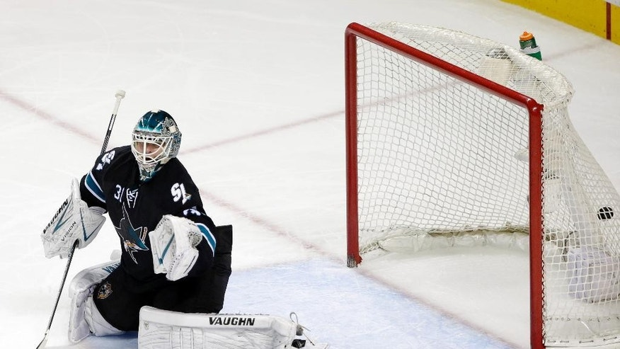 San Jose Sharks goalie Antti Niemi, of Finland, is beaten for a goal on a shot from Boston Bruins' Torey Krug during the second period of an NHL hockey game Thursday, Dec. 4, 2014, in San Jose, Calif. (AP Photo/Marcio Jose Sanchez)