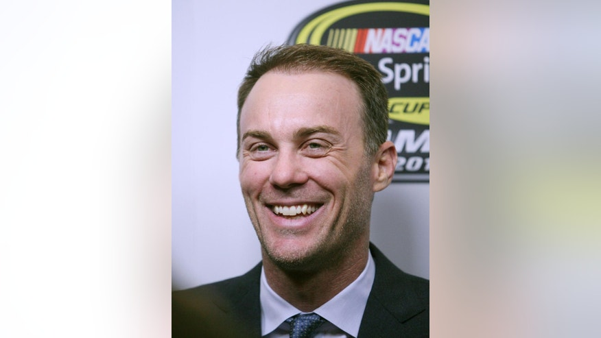 NASCAR driver Kevin Harvick laughs while speaking to the news media at the NASCAR NMPA Myers Brothers 2014 Awards Luncheon Thursday, Dec. 4, 2014, in Las Vegas. NASCAR drivers are in town for Champion's Week. (AP Photo/Ronda Churchill)